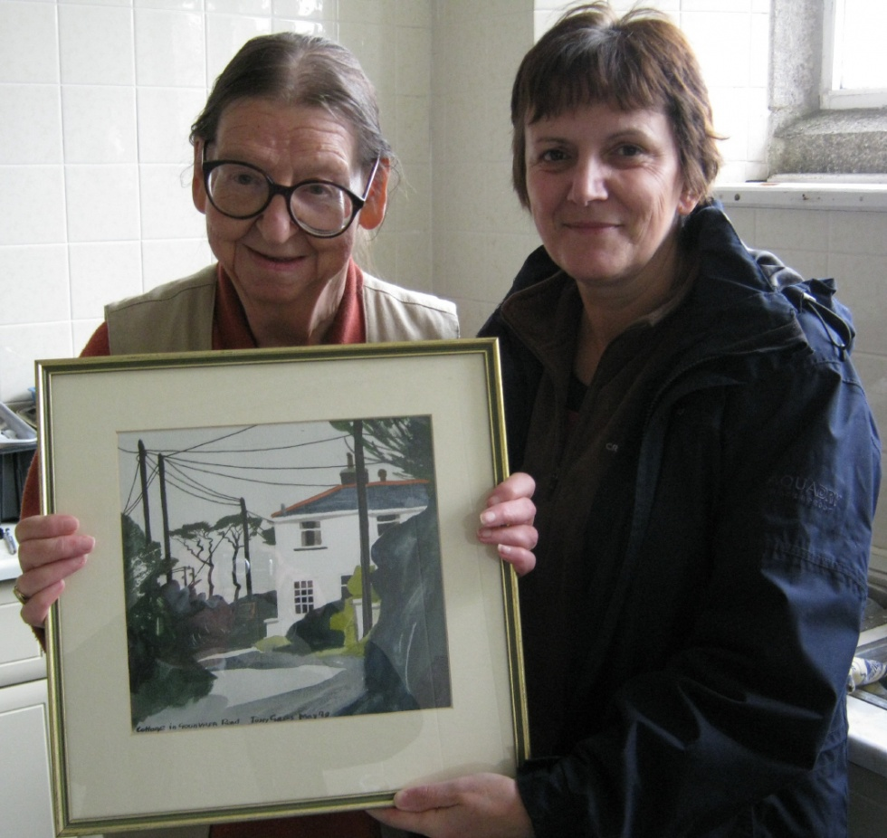Hilary Giles (left), with Clare Murton, Museum Curator, with the newly acquired watercolour, at the Coffee Morning