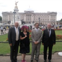Clive Benney, Roger Radcliffe, Ann Oxley and Colin Harris outside Buckingham Palace.