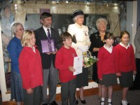 Liz Thompson, Roger Radcliffe, Lady Mary Holborow and Councillor Pat Harvey with four Y5 students in front