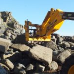 Granite harbour stone being removed from Trevaunance Cove